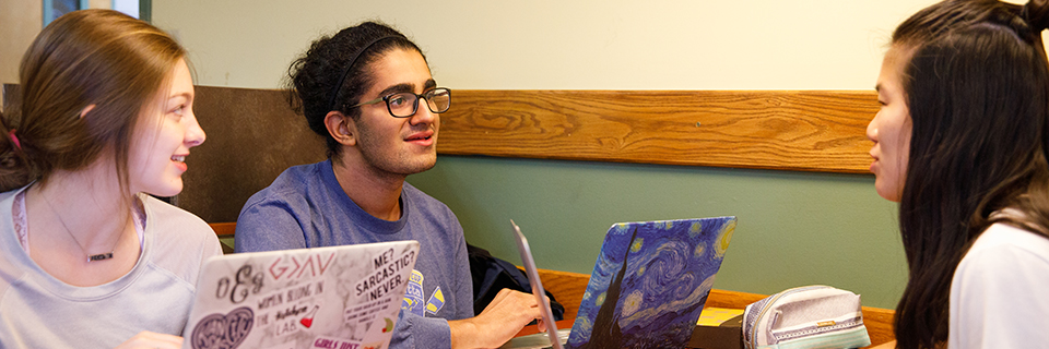 Three students studying at Einstein's on Rockhurst's campus
