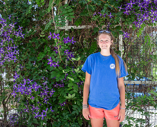 Hannah Nelligan stands in front of pergola