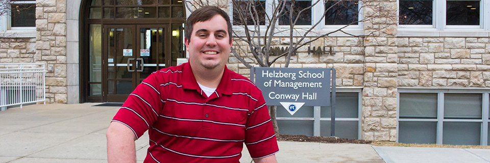 Kevin Burjarski sits on a bench outside of Conway hall