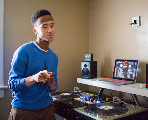Nick Davis stands in front of his turntables