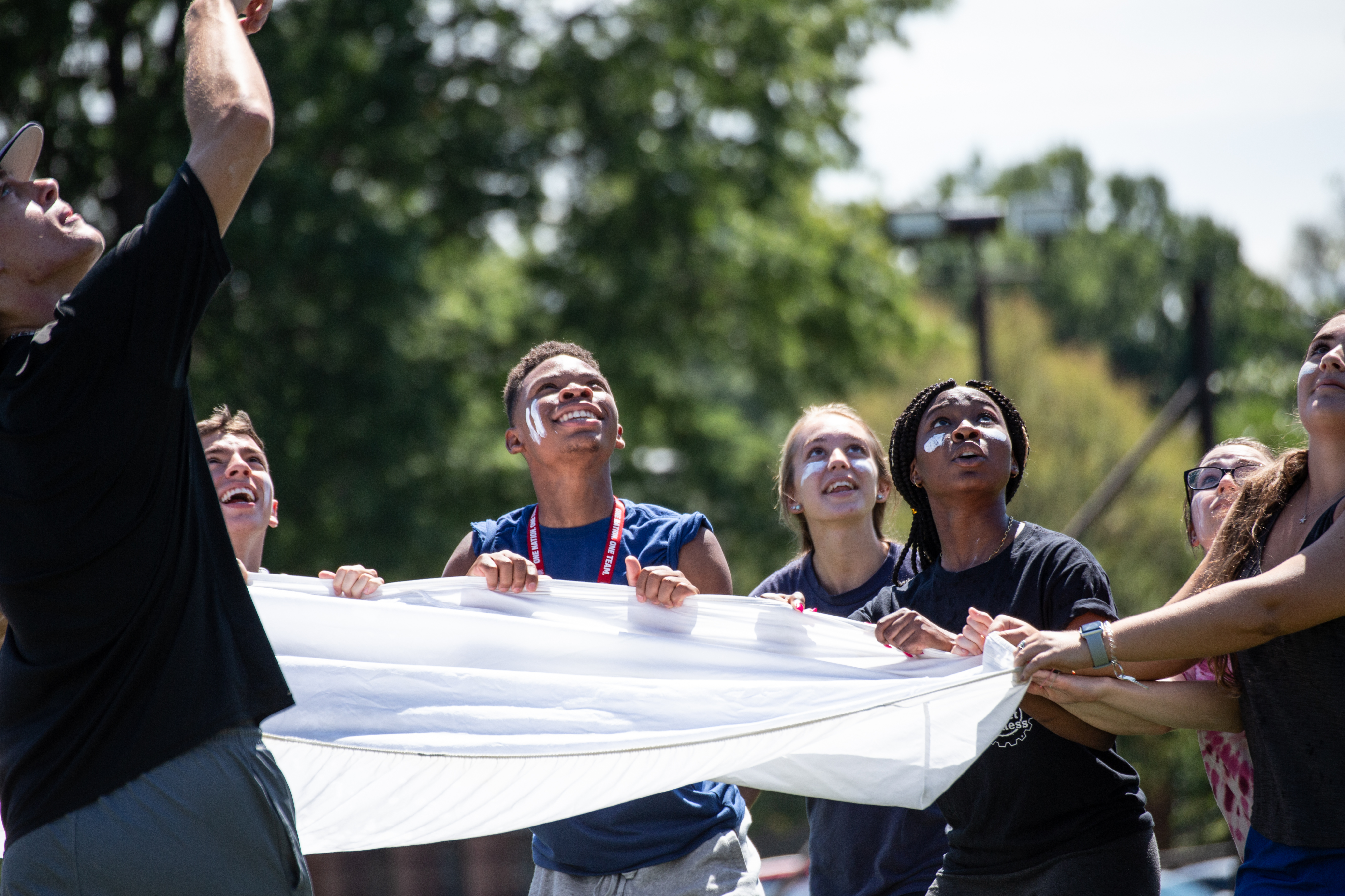 Students Catch a Water Balloon in Orientation Olympics