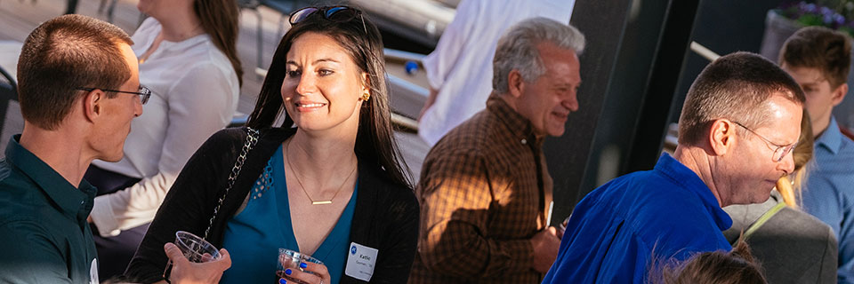 Alumni at networking event