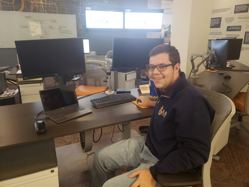 Intern, Connor Berry, working at his desk