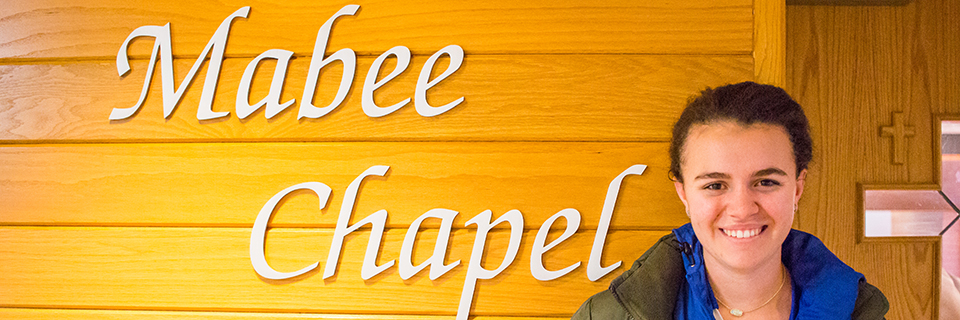 Clare Mitchell stands outside of the Mabee Chapel.
