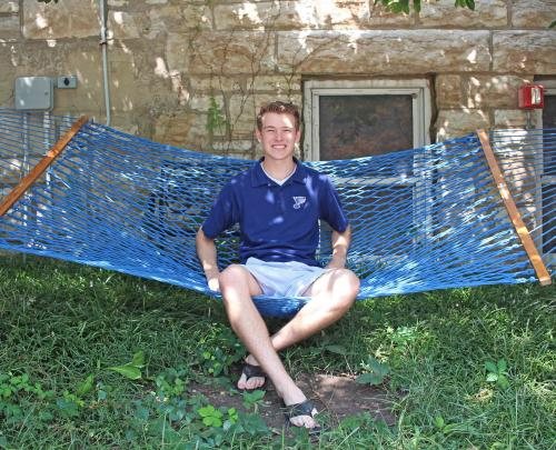 Connor Larson sits in a hammock