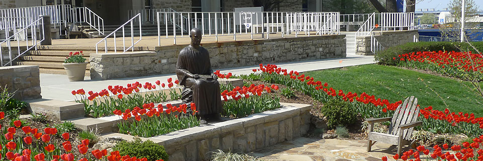 Ignatius Statue with Tulips