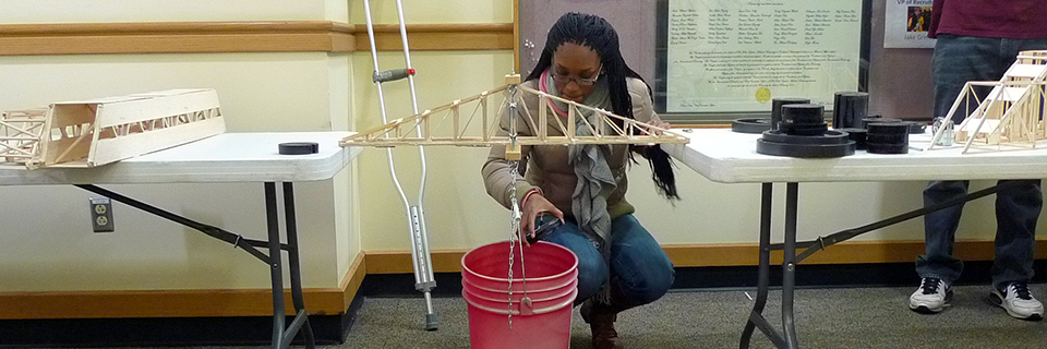 Female engineering student at Rockhurst university working on a project.