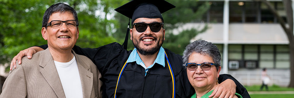 Graduating student with parents