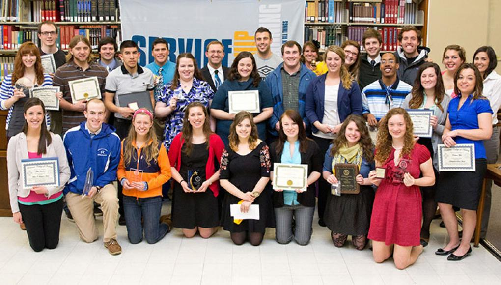 A group of students accepting awards
