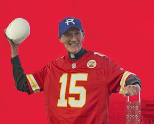 Fr. Curran wearing a Chiefs jersey