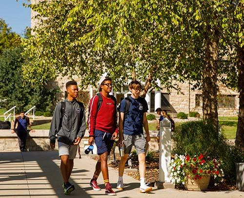 students walking across the quad