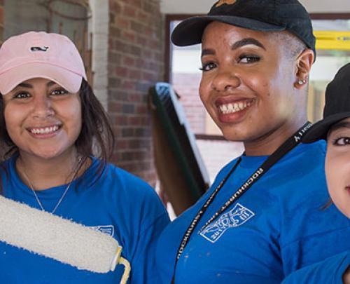 Students painting volunteering