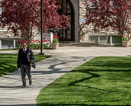 Student walking on the quad