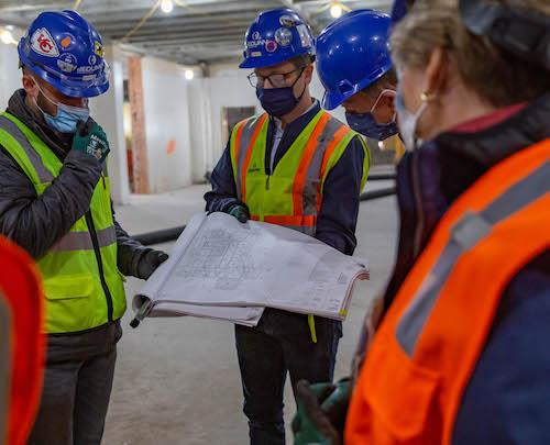 Staff and alumni on a tour of campus construction