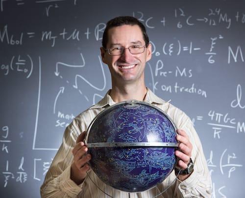 Mark Pecaut holding a globe
