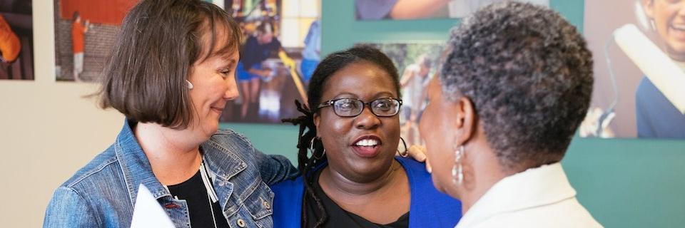 Volunteers and staff talk at the Rockhurst University Community Center