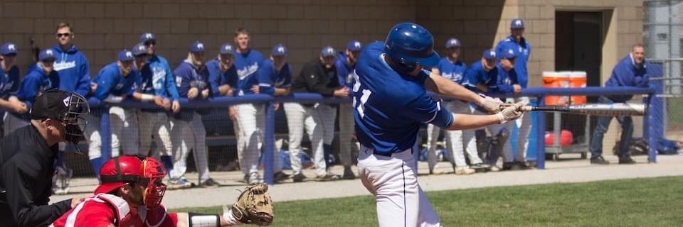 Baseball player swings the bat