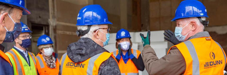Alumni and staff on a tour of a construction site