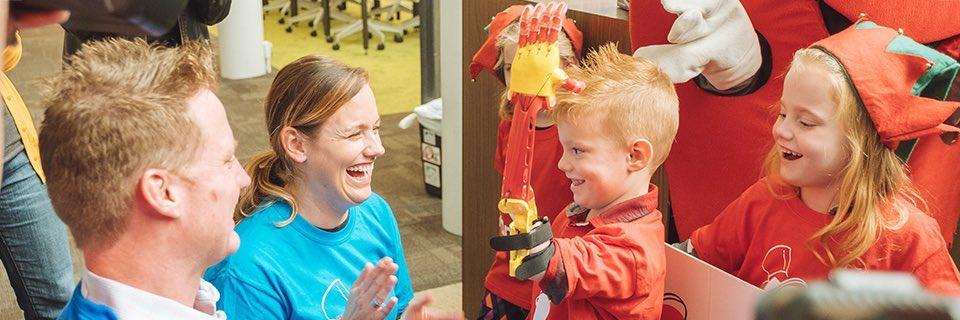 Hudson Borton and family celebrate his new prosthetic arm