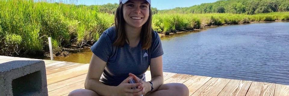 Senior Mary Strecker on a dock during an internship