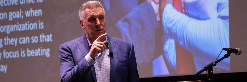 Peter Vermes speaks at a Young Alumni Council event