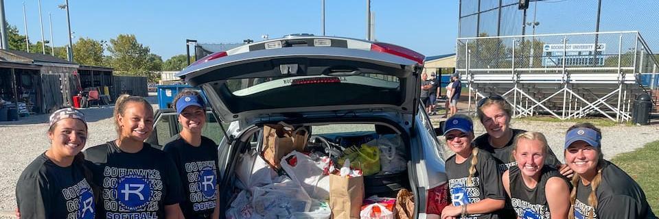 Softball players donating food