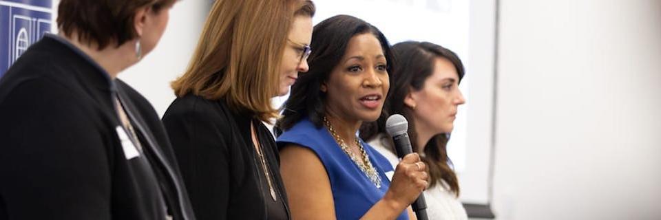 Women speaking at a leadership panel