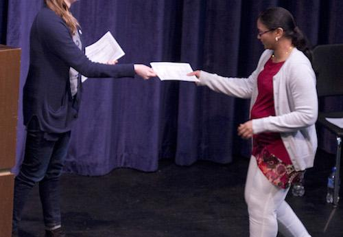 Student accepting a certificate on stage