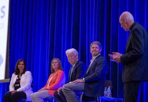 Leaders on stage at the leadership series event