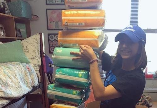 RU Sophomore Stephanie Lopez with the diapers she donated to Hurricane Harvey victims