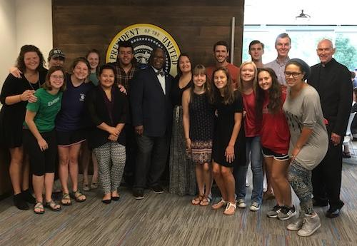 Students with Fr. Curran and Mayor Sly James
