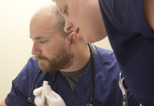 Nursing students take care of a patient