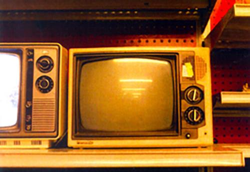 Television sets on a shelf