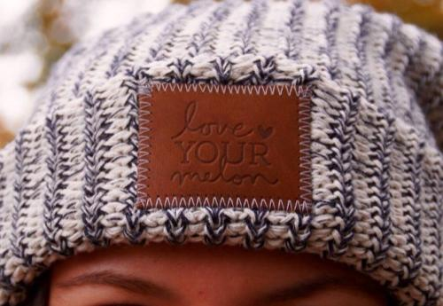Student modeling a Love Your Melon beanie