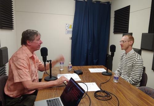 Tim McDonald, Ph.D., talks to a guest