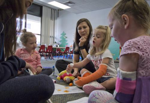 Therapists and children at Ability KC