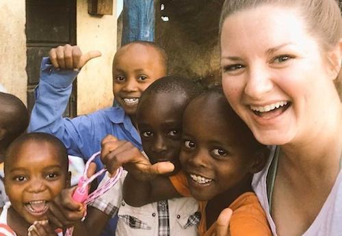 Alumna Jenny Buehler and children in Tanzania