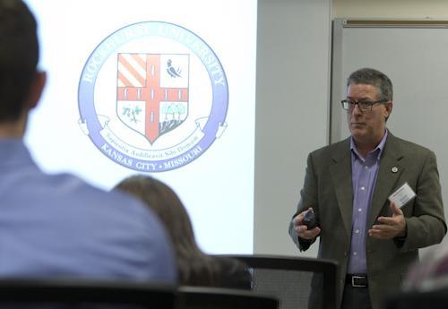 Speaker talks to a class