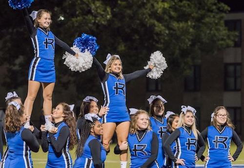 Cheerleaders performing at a soccer game