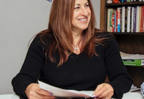 Risa Stein in her office with students