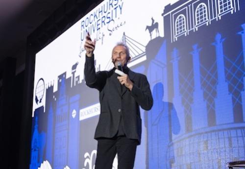 Joe Montana speaking on stage