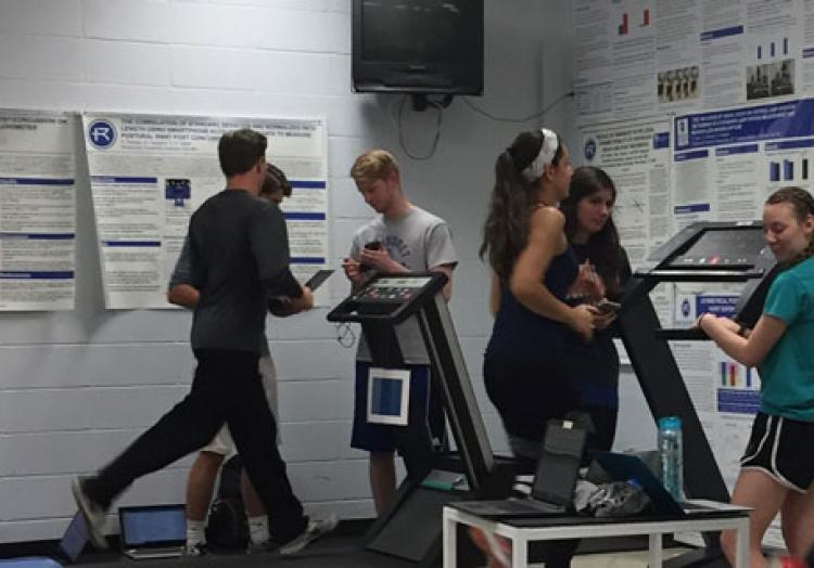 Exercise Science students explore heart rate and vital signs while running on treadmills