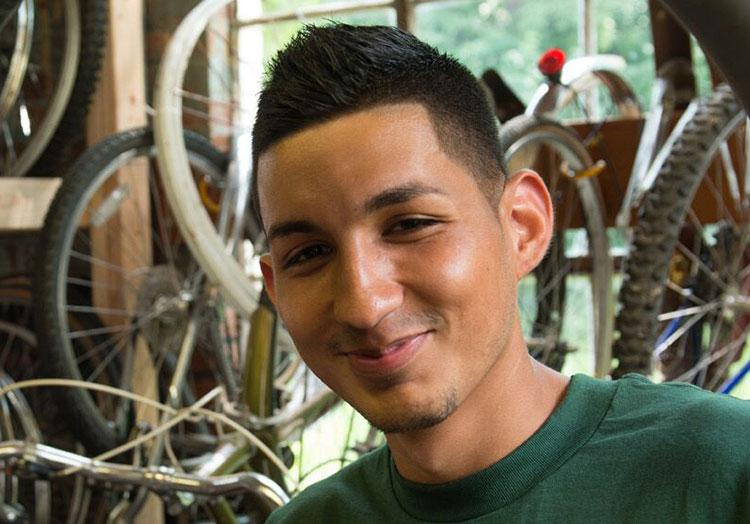 Student serving in local bicycle shop