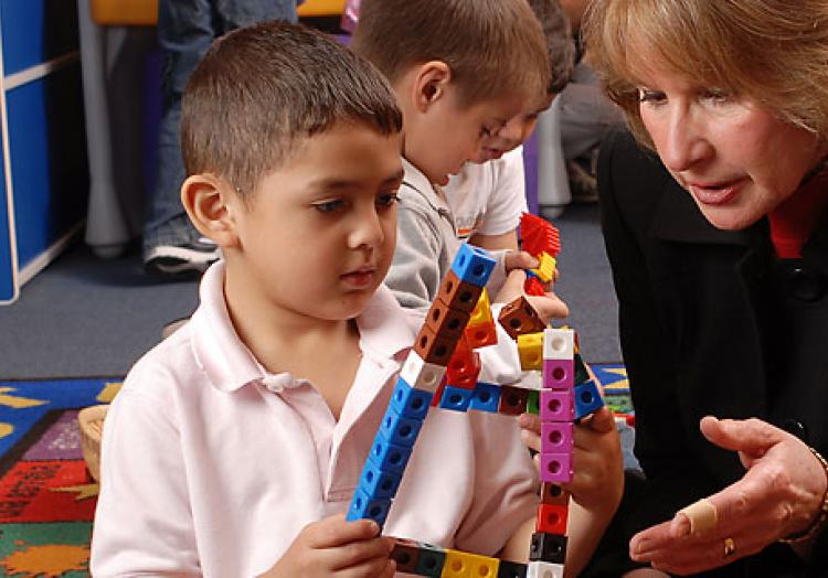 Children learning with professor
