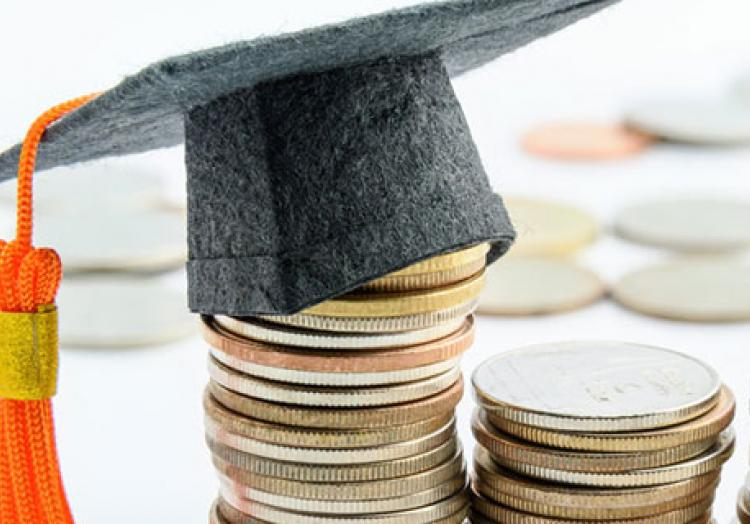 Graduation cap on stack of coins