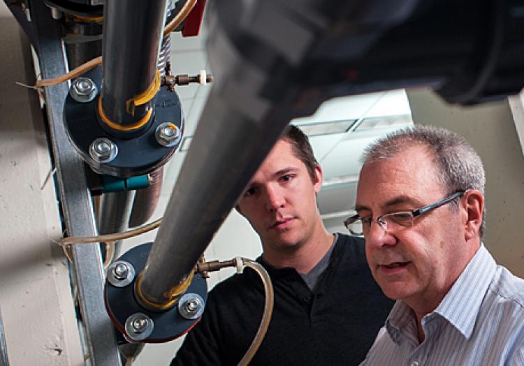 Professor teaching students mechanical engineering