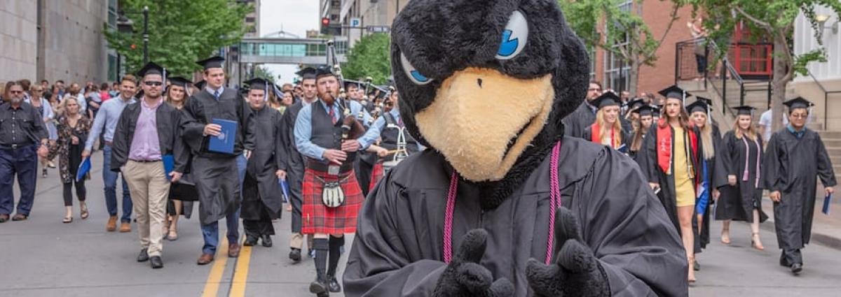 Rock E. Hawk leading a graduation parade