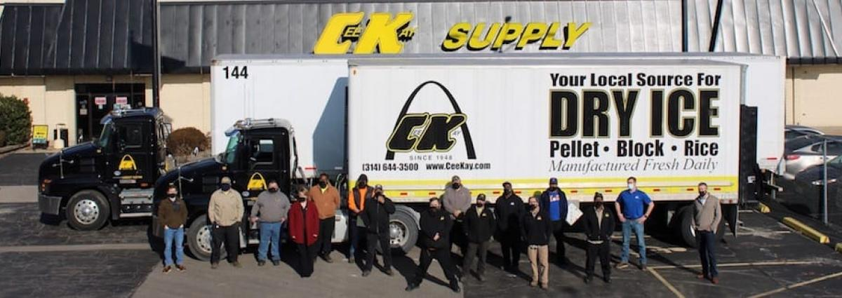 Employees of CeeKay Supply in front of a dry ice truck
