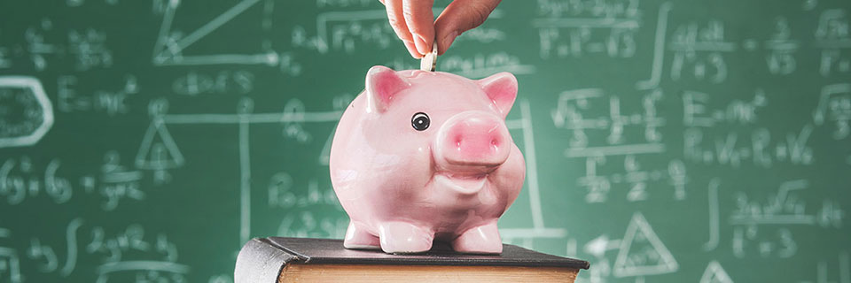 Piggy bank in front of chalkboard