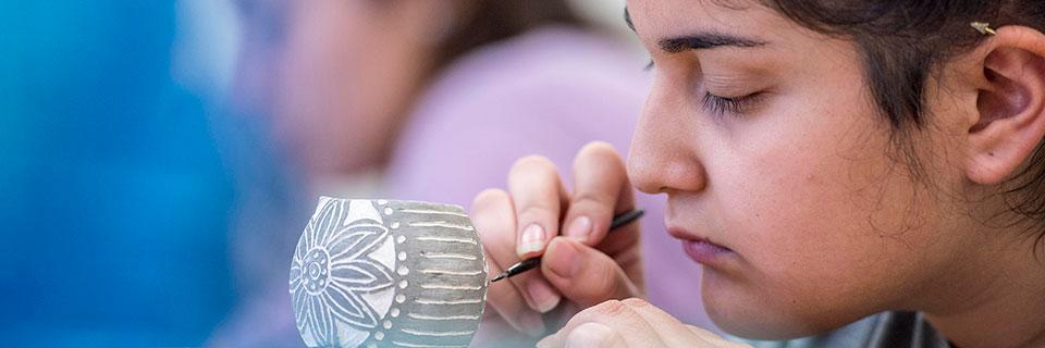 Student painting ceramics